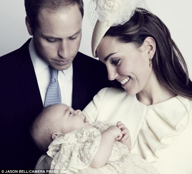 Adorable: Prince George beams at Kate as their eyes meet, and William looks on proudly