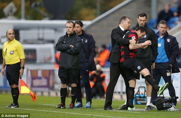 Temper, temper: Peterborough boss Darren Ferguson holds Lee Tomlin as he kicks out after being sent off