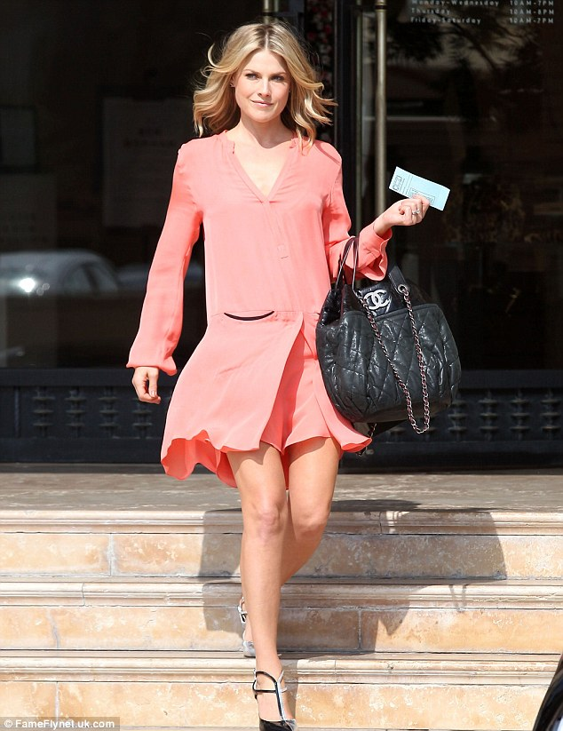 Sleek and sophisticated: Ali Larter did some shopping at Barneys in a chic orange shift dress