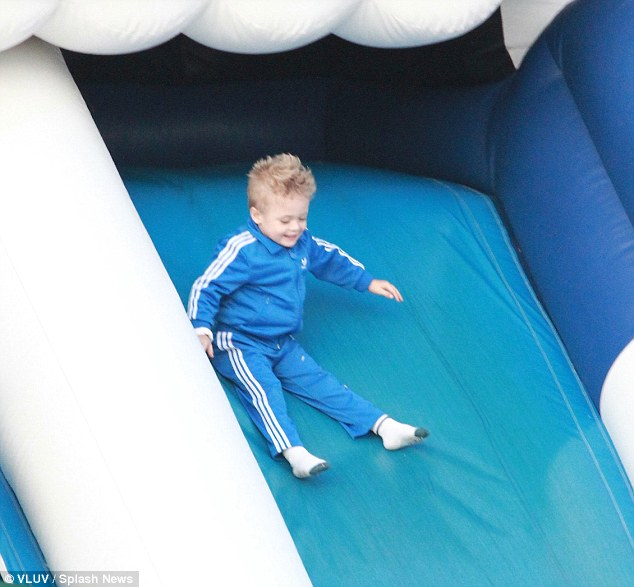 Camouflaged: Little Julian matched the colour of the slide as he careered down it with a huge smile