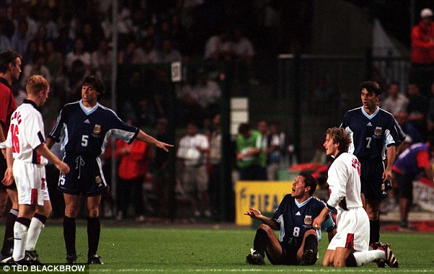 Moment of madness: David Beckham is sent off at World Cup 1998 after kicking out at Diego Simeone