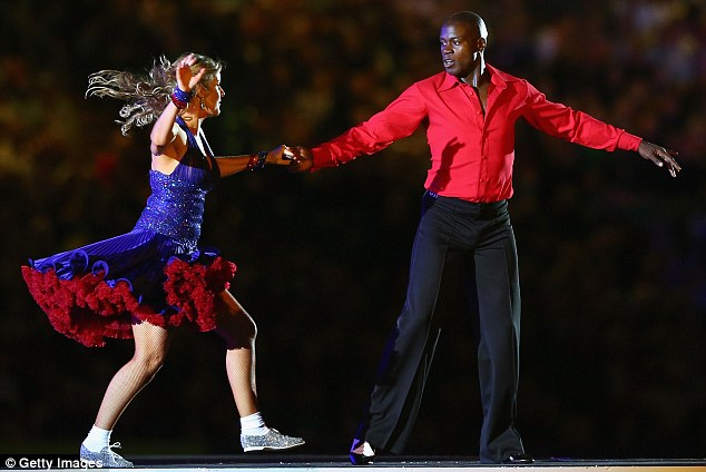 Twinkle toes: League legend Martin Offiah shows off his dancing skills as part of the opening ceremony