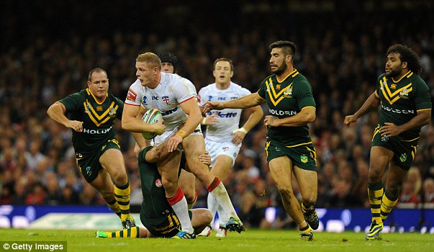 Menacing: George Burgess was outstanding, battering Australia's forwards and coming close to scoring