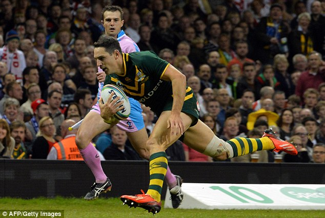 Going solo: Billy Slater received the ball from a scrum in his own half and ran 60m to score on half-time
