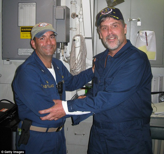 Rescue: Captain Phillips, right, with Commander Frank Castellano of the USS Bainbridge