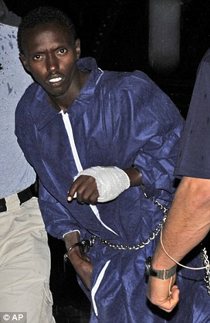 A captured Somali pirate is held in custody by U.S. officials