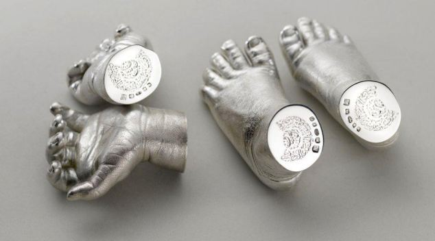 Keepsake: However her £7,000 gift for George, a solid silver copy of his hands and feet, has raised eyebrows