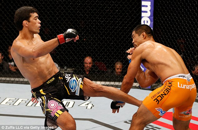 Swing: Lyoto Machida kicks Mark Munoz in their middleweight bout in Manchester