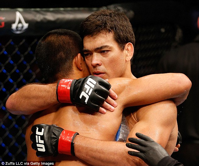Pals: Lyoto Machida hugs opponent and friend Mark Munoz after Machida's knockout victory