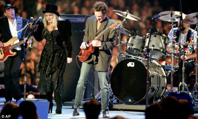 United: Band members Mick Fleetwood, Stevie Nicks and Lindsay Buckingham said in a statement they were sorry to cancel the 14 show dates but that John, far left, and his treatment came first
