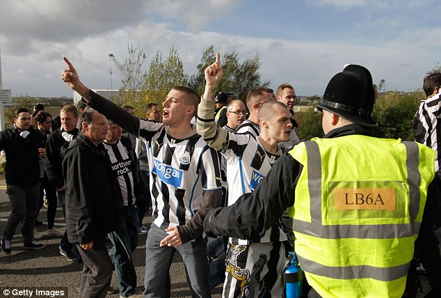 Black and white army: Newcastle United fans arrive ay the Stadium of Light under a heavy police guard