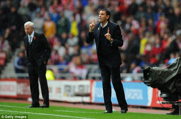 Instructions: Gus Poyet (foreground) and Alan Pardew issue commands from their technical areas as the rain comes down