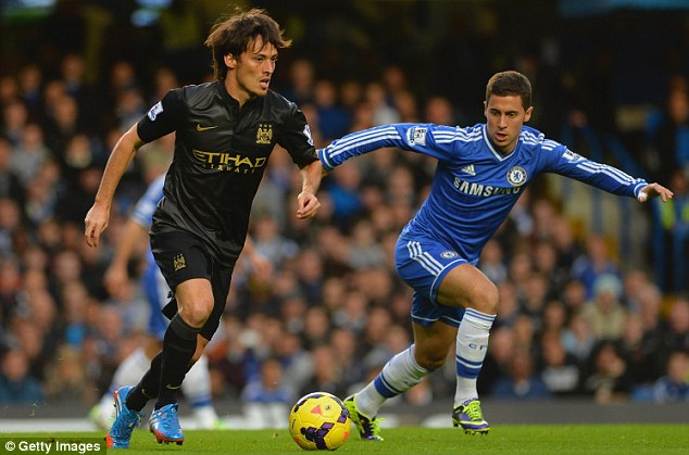 Arm's length: City's David Silva is marshalled by Chelsea's Eden Hazard during the opening stages of the match