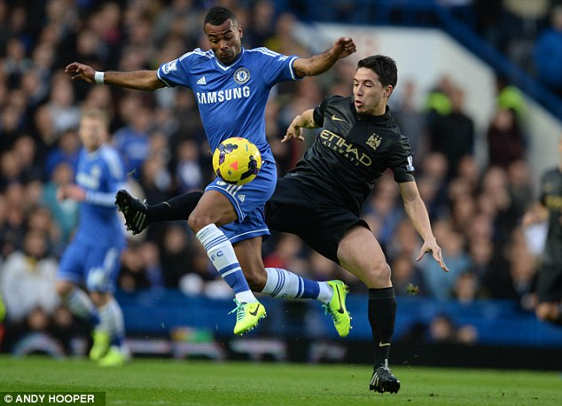 Aerial battle: Ashley Cole vies for possession with Manchester City's Samir Nasri (right)
