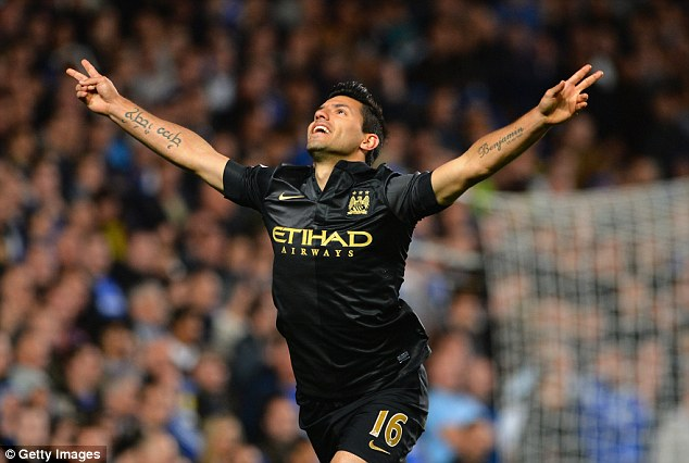 Stunner: Sergio Aguero celebrates his magnificent equaliser for City early in the second half