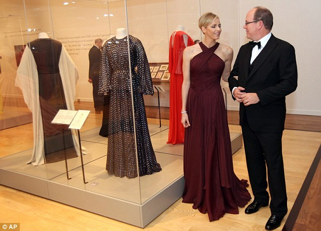 Cheerful: The royal couple appeared happy and relaxed as they toured the exhibit in the Michener Museum of Art