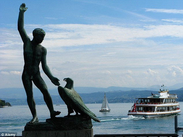 On the waterfront: A statue of Greek hero Ganymede next to Lake Zurich