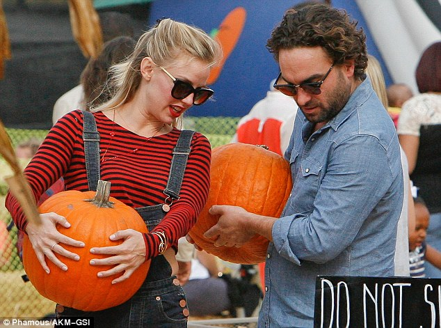 The perfect pick: Johnny and Kelli carefully look at the pumpkins while at the patch