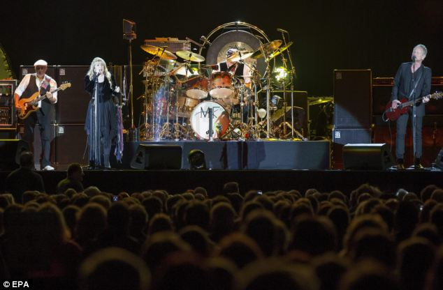 Still drawing the crowds: After a staggering 15 different changes the reunited Fleetwood Mac remain popular across the generations and played to sold out crowds at the O2 arena London last month