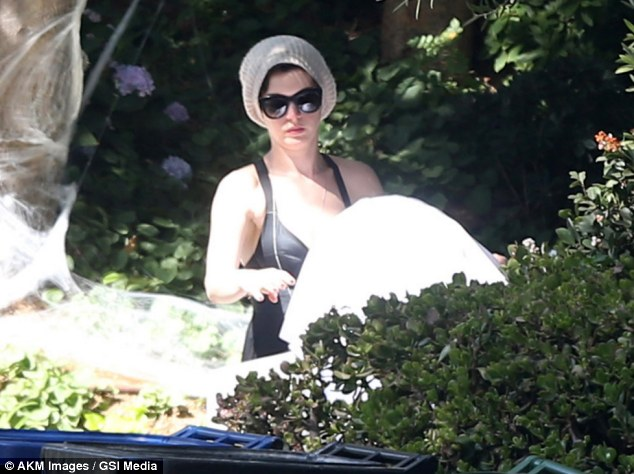 Halloween spirit: Anne Hathaway gets ready for the upcoming holiday and decorates her Los Angeles home