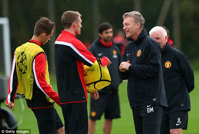 Back in the frame: David Moyes chats with Fletcher after the midfielder returned to training