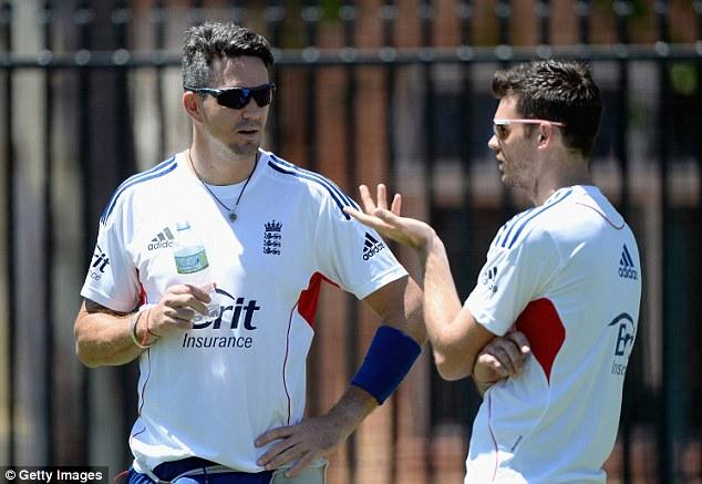 Forward planning: Pietersen talks with England team-mate James Anderson