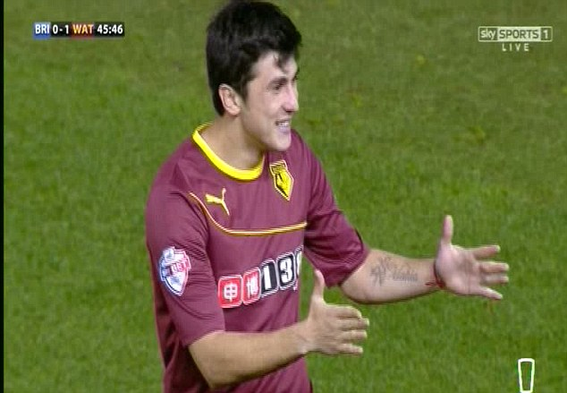 Protest: Fernando Forestieri, who hit the initial shot, signals to the referee that ball has crossed the line