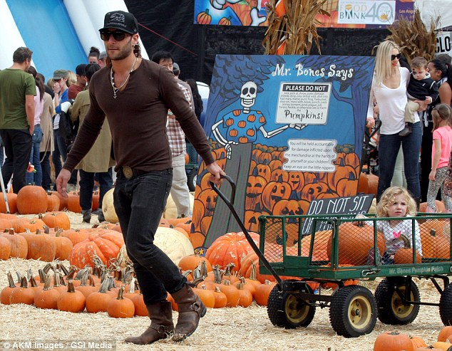 All aboard! Actor Zach McGowan spends his Sunday with his daughter at Mr. Bones Pumpkin Patch in West Hollywood