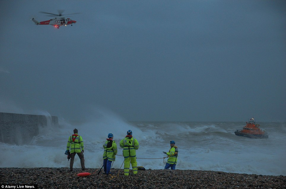 Team effort: A lifeboat and coastguard helicopter search the sea off Newhaven for the missing 14-year-old boy yesterday afternoon