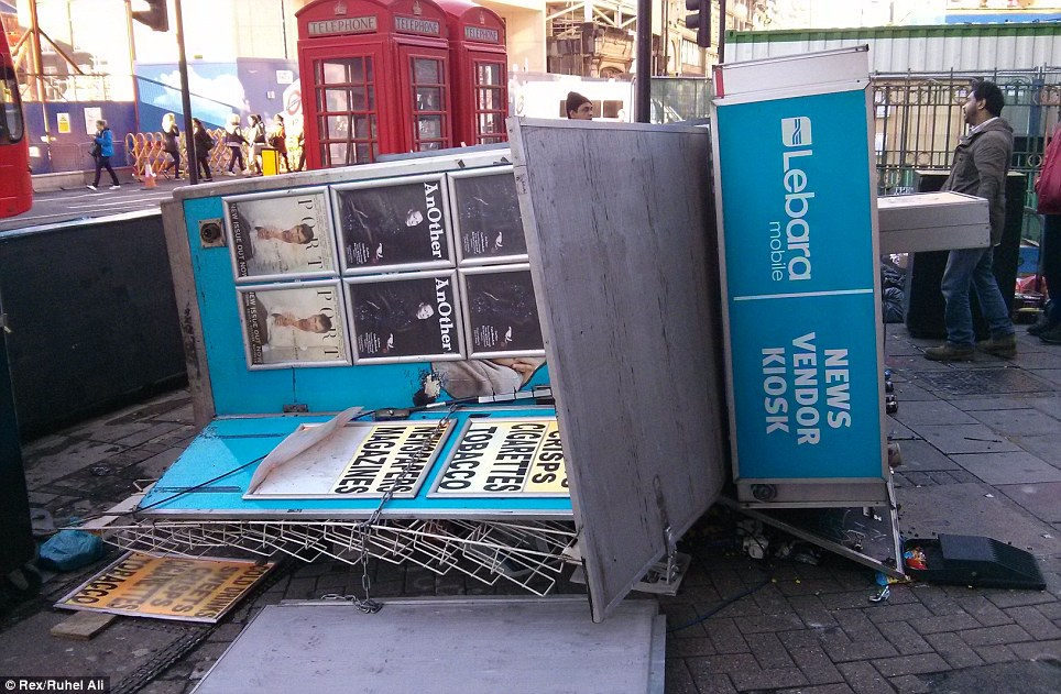 Media storm: A news stand knocked over by wind on Tottenham Court Road in central London