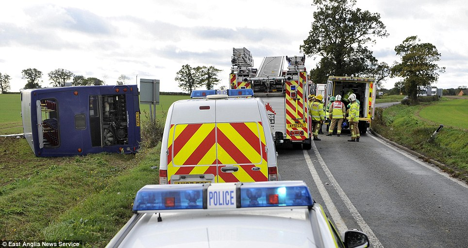 Emergency services at the scene of an overturned double decker bus on the A1071 near Hadleigh in Suffolk