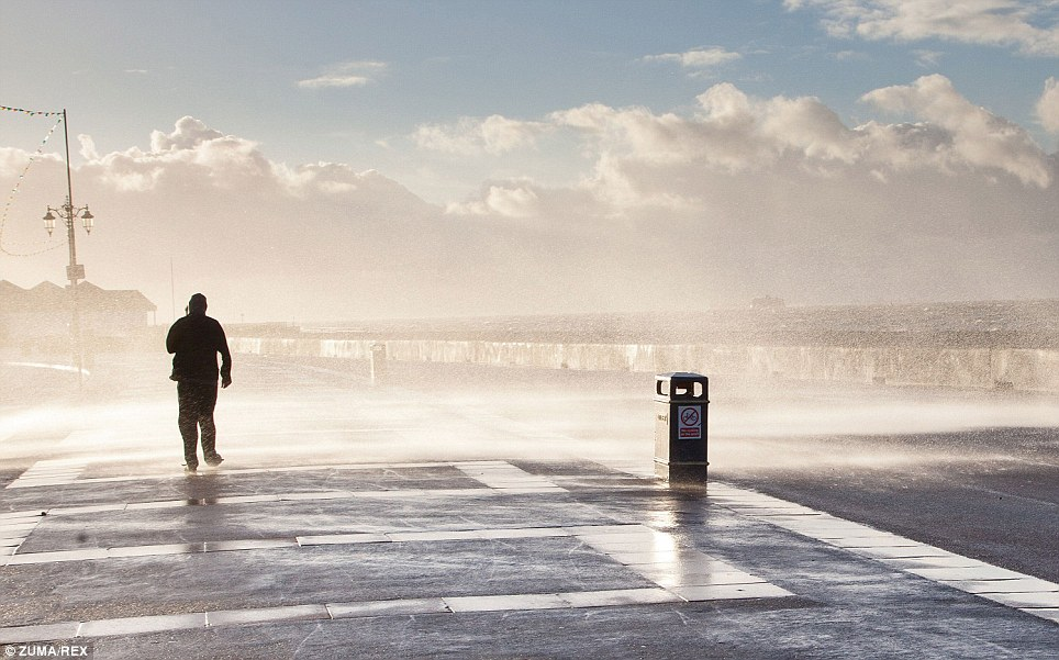 Spray: Waves crash on Clarence Esplanade at Southsea in Portsmouth, Hampshire, as storms batter Britain