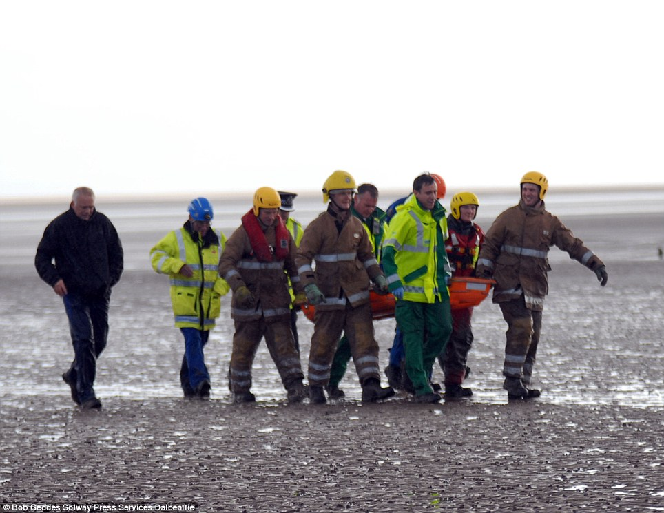 Safety: Holidaymakers watched the drama 100 yards from the popular beach on the Solway Firth as the girl was stuck in the mud for around 90 minutes