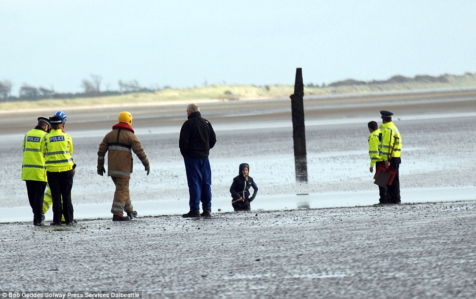 Trapped: Coastguard teams, police and firefighters used special equipment to reach the girl and free her at Sandyhills Bay in Kirkcudbrightshire, Scotland
