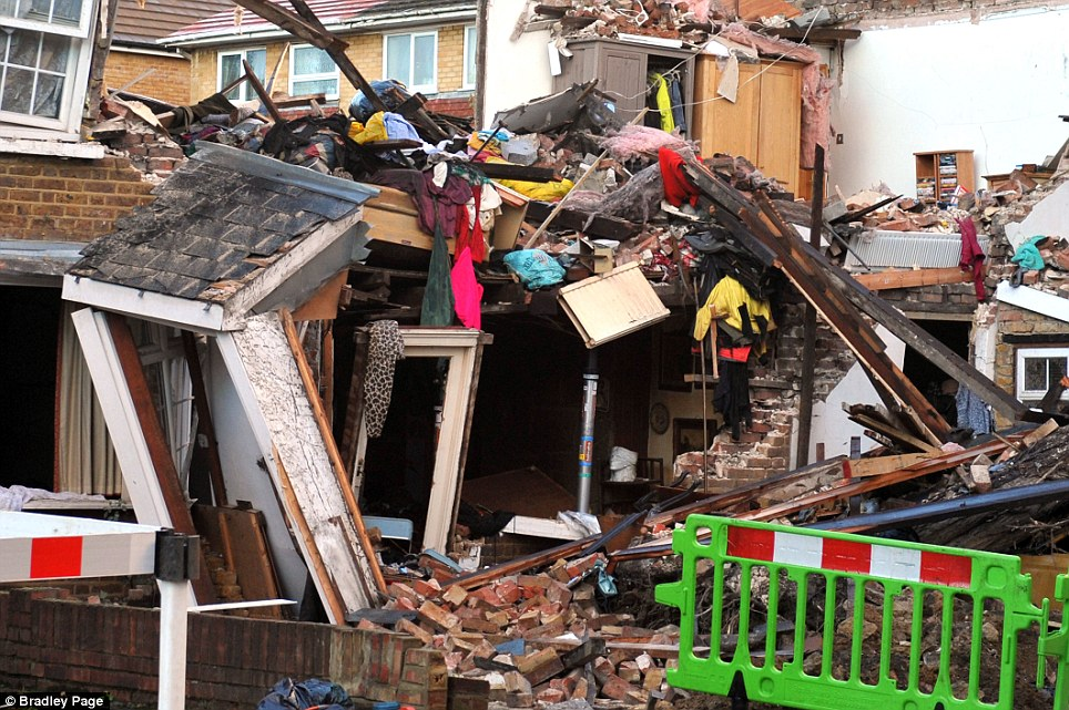 Destruction: The scene at Bath Road in Hounslow, west London, after a falling tree hit a gas main, causing an explosion during the major storm