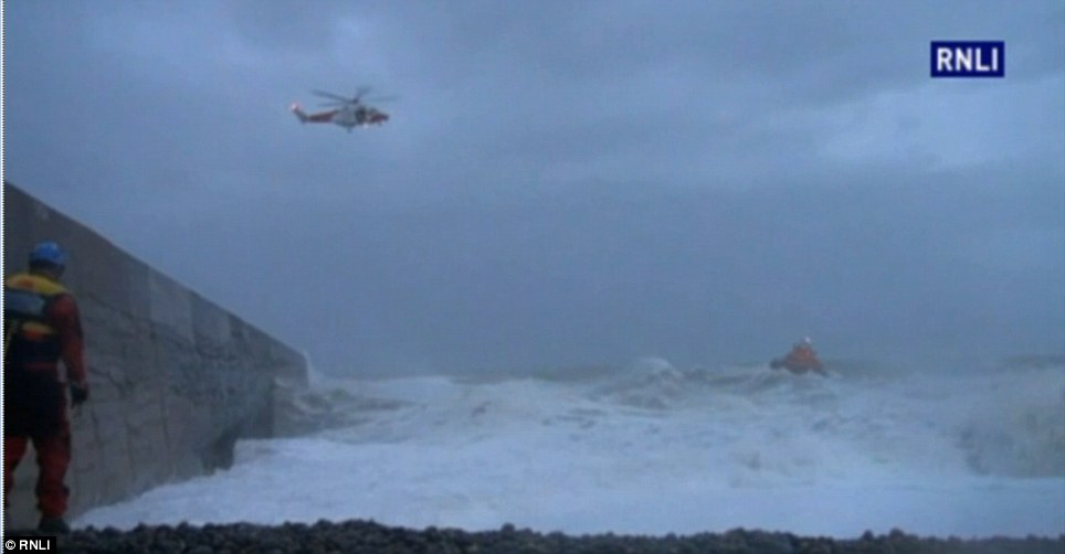 A teenage boy is also feared dead after being swept out to sea in Newhaven, East Sussex, on Sunday afternoon