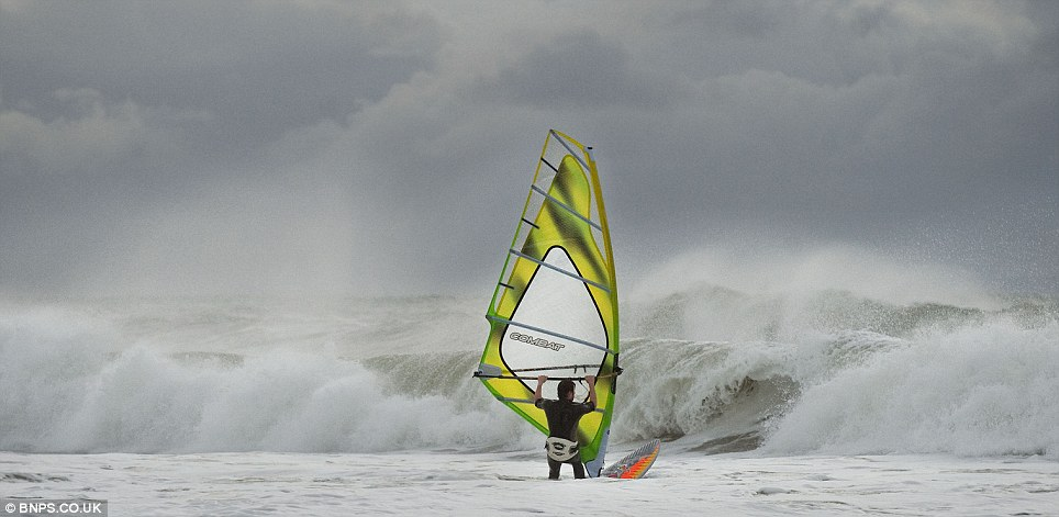 A lone surfer takes to the seas amid the worst storm to hit the country in years