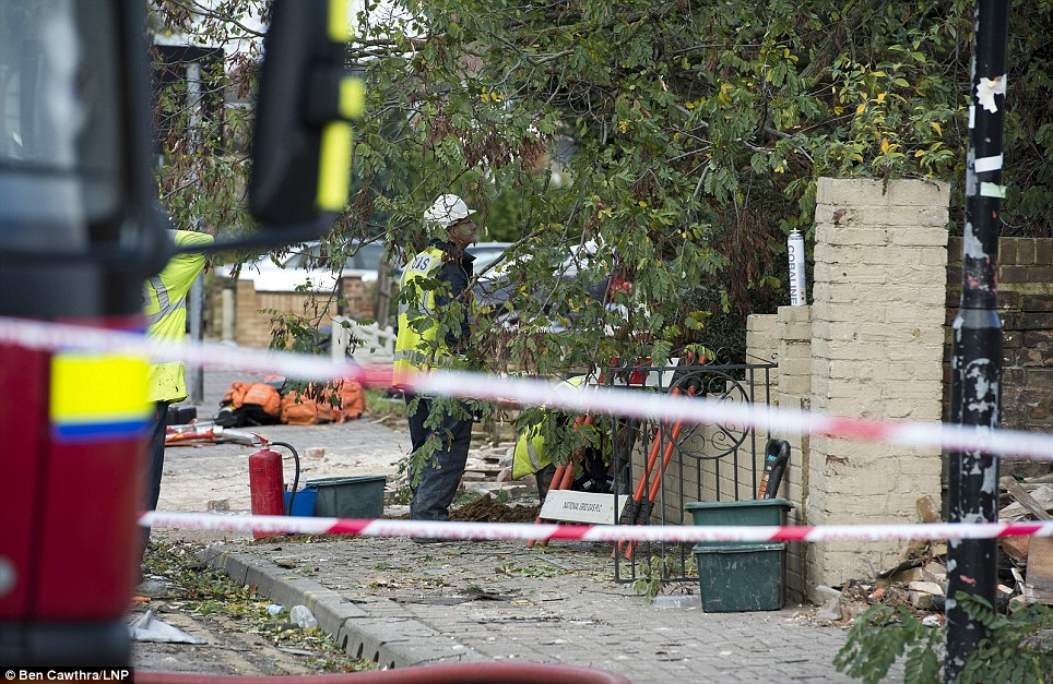 National Grid workers at the scene in Hounslow. Around 30 firefighters and six engines were sent to the scene just after 7am