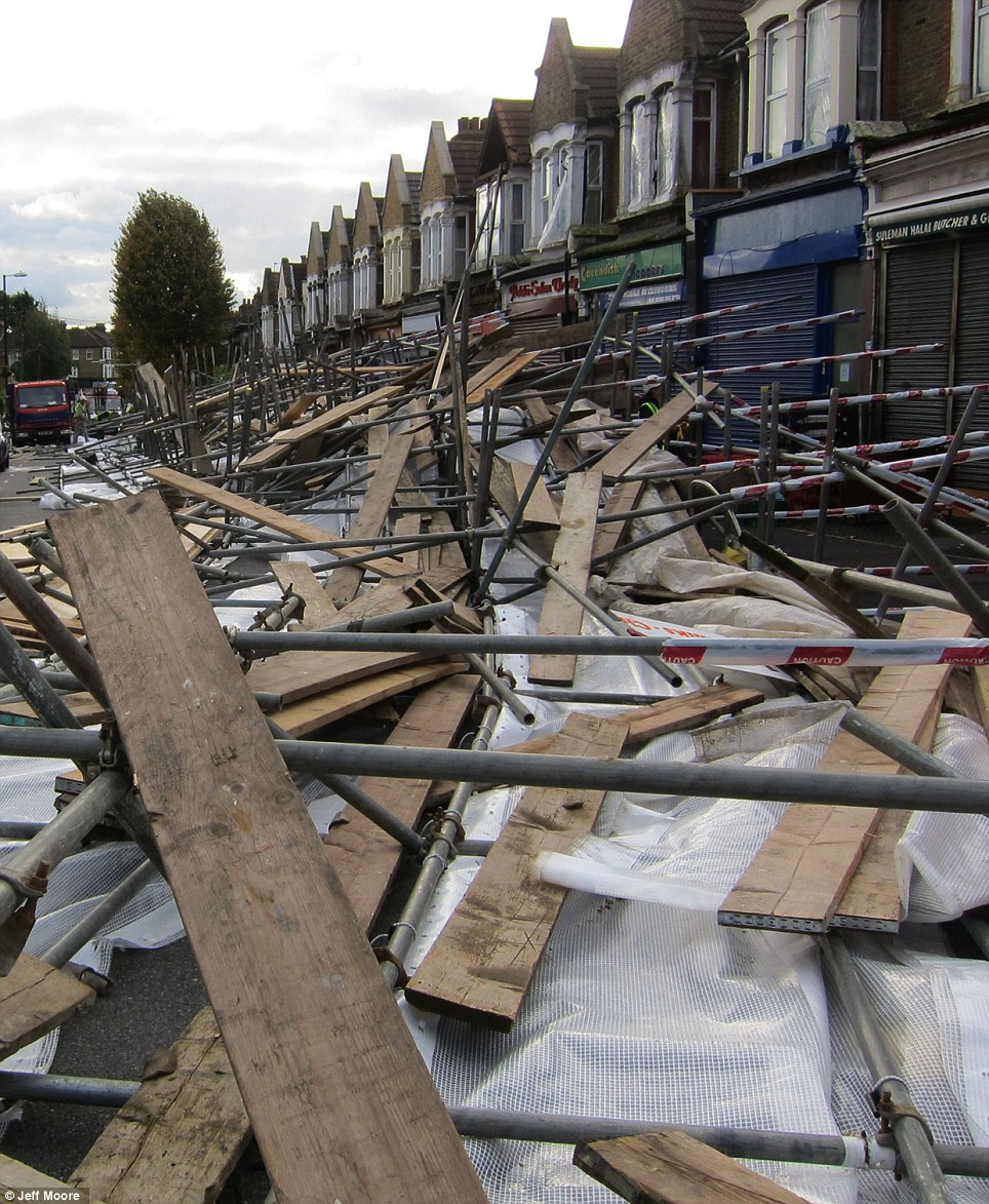 In Leyton, east London, Francis Road was blocked when 100 metres of two-storey scaffolding was ripped from the row of shop fronts in the early hours