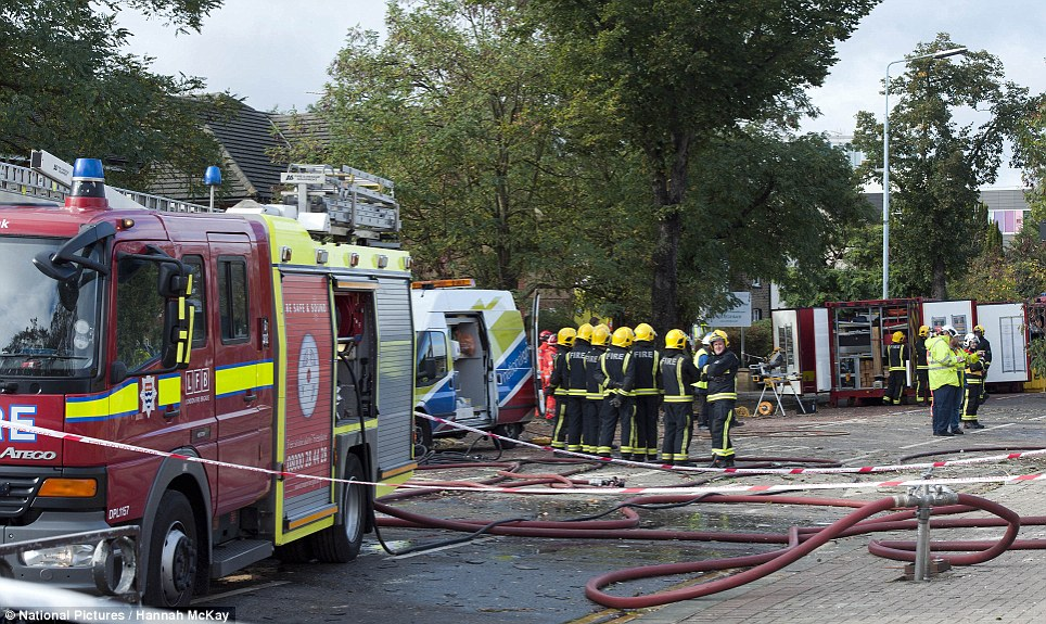 Firefighters at the scene of an explosion involving three houses in Hounslow, west London. Properties on Bath Road were damaged after a tree fell through a pipe