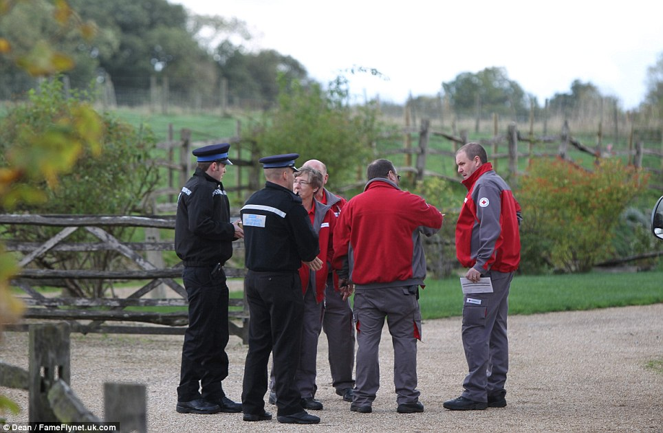 Teams gather at the scene in Hever. Kent woke yesterday morning to winds reaching topping 80mph and more than 100 trees felled