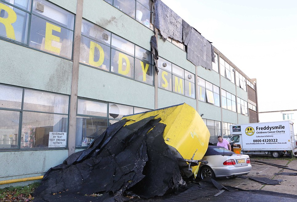 A Mercedes parked outside a building in Sussex has been crushed by a falling debris amid the storms