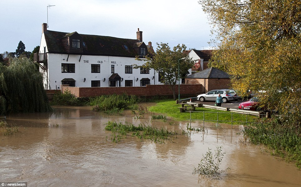 A pub by the River Stour appears to  have been cut off by the heavy rainfall in Warwickshire