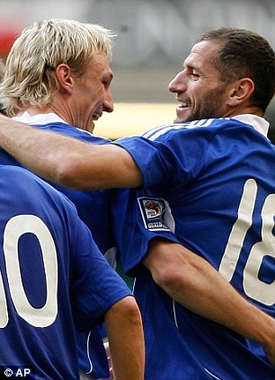 Finland's Shefki Kuqi, right, celebrates scoring with teammate Sami Hyypia during their World Cup Group 4 qualifying match against Wales 2009