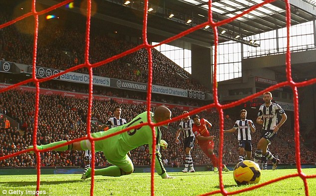 And he's off: Suarez scores the first of his three goals in Liverpool's weekend win over West Brom at Anfield