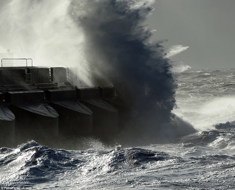 A boat broke its moorings and was washed up on the beach as the giant waves attacked the Brighton coast. Hurricane-force winds and torrential rain is battering southern England with gusts of almost 100mph