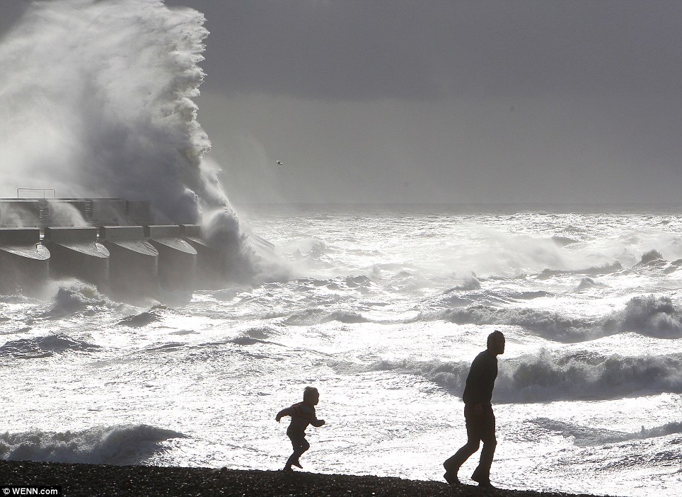 Hurricane winds batter the Brighton coast as a child and an adult force their way through the storm