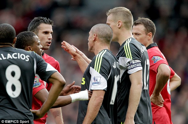 Manchester United's Robin van Persie (left) Stoke City's Jonathan Walters (centre) and Captain Ryan Shawcross (right) argue during the Barclays Premier League match Manchester United v Stoke City at the Old Trafford, Manchester.