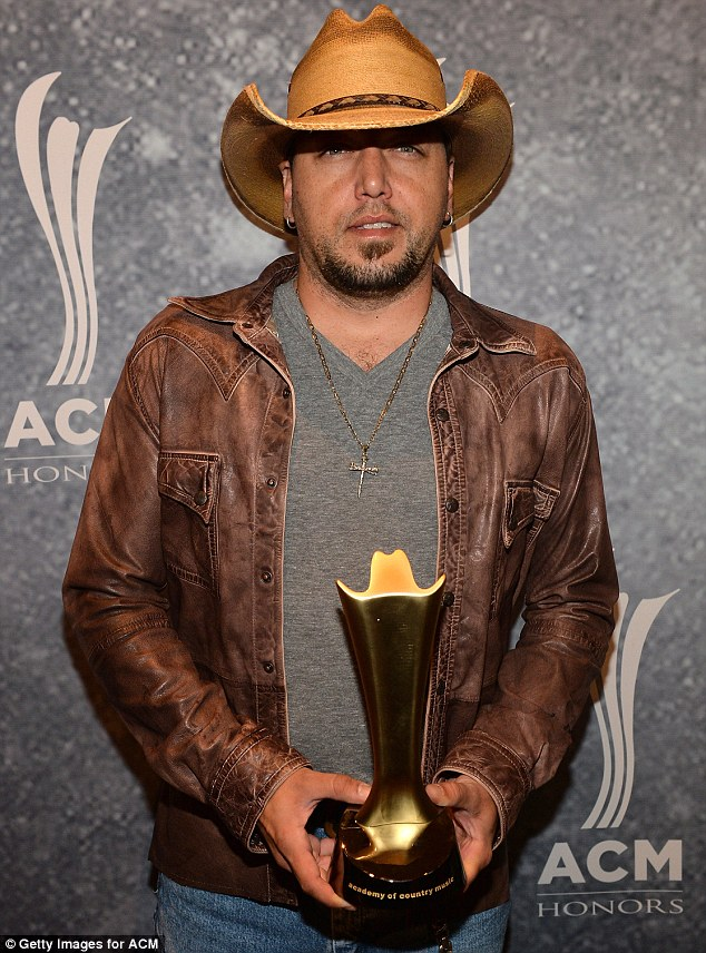 Jason Aldean, pictured in September in Nashville, was on board his tour bus in the early hours of Monday when it hit and killed a pedestrian in Indiana