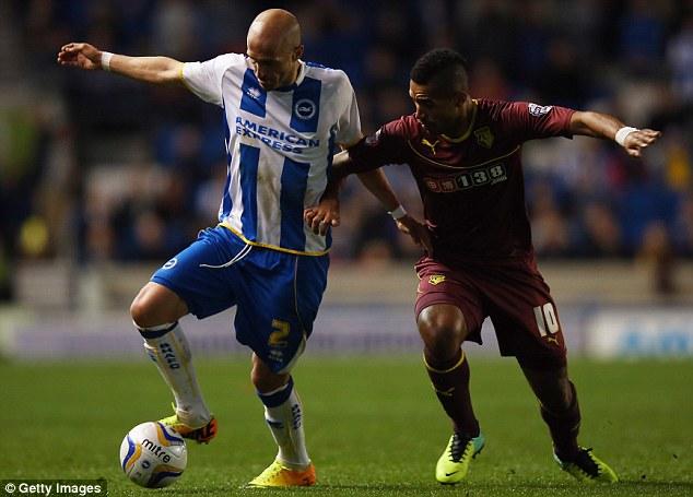 Battle: Brighton defender Bruno shields the ball from the challenge of Watford midfielder Lewis McGugan